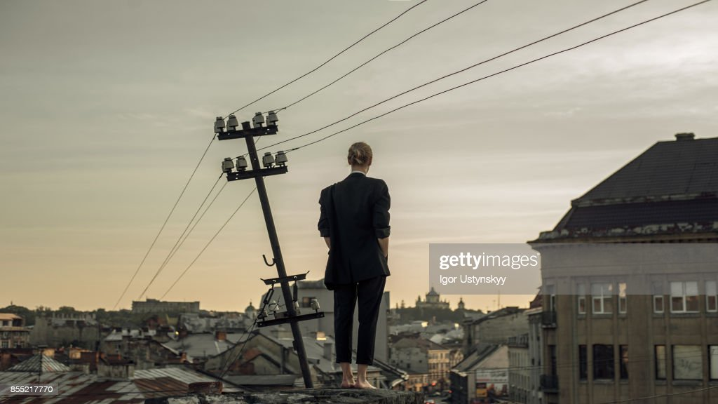 Portrait  of woman  on the roof : Stock Photo