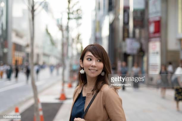 portrait of woman on the street - donne di età media foto e immagini stock