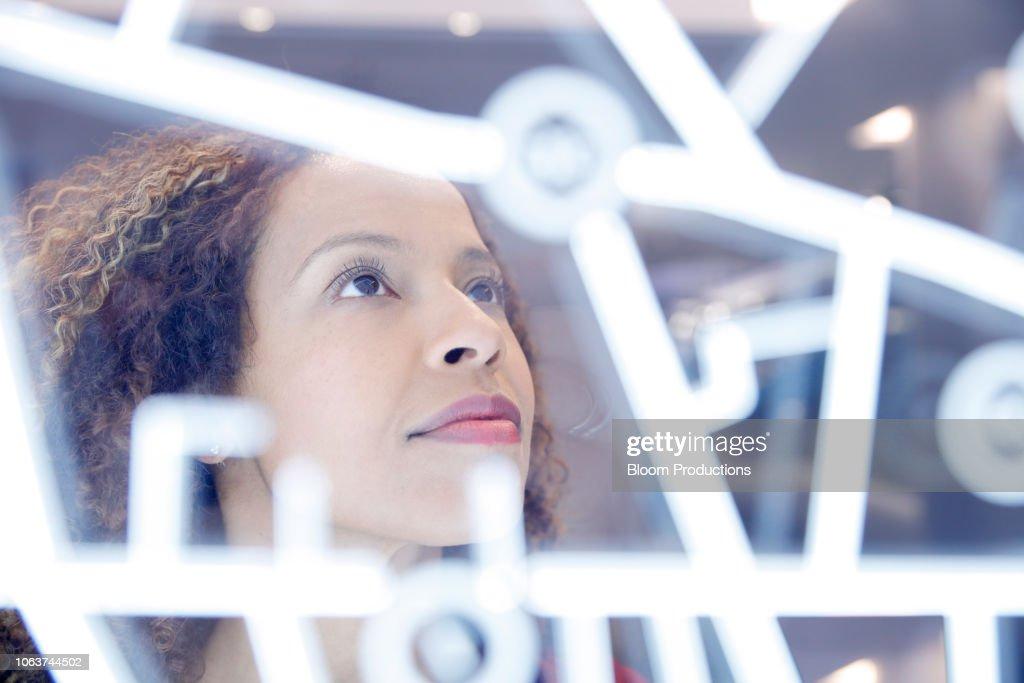Portrait of woman operating digital interface technology : Stock Photo