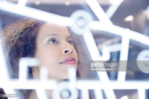 portrait of woman operating digital interface technology - solutions stock pictures, royalty-free photos & images