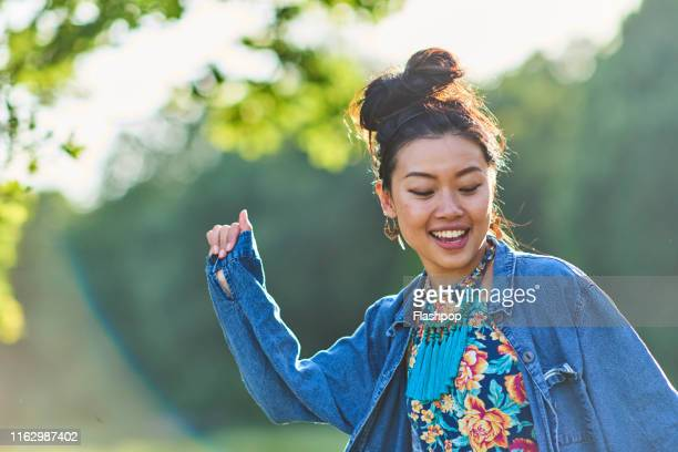 portrait of woman outdoors - lifestyles stock pictures, royalty-free photos & images
