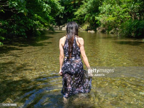 portrait of woman - waist deep in water stock pictures, royalty-free photos & images
