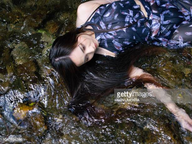 portrait of woman - dead body in water stock pictures, royalty-free photos & images