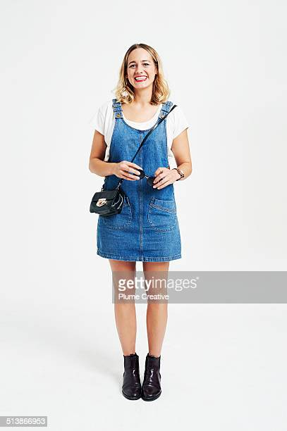 portrait of woman - denim dress stock photos and pictures