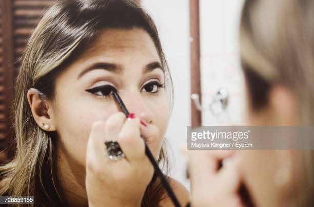 portrait of woman - eye liner stock pictures, royalty-free photos & images