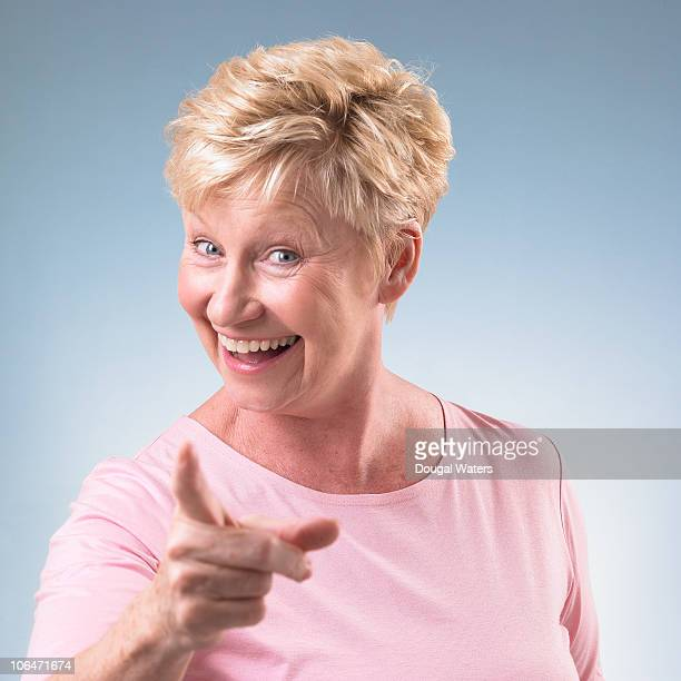Portrait of woman pointing finger.