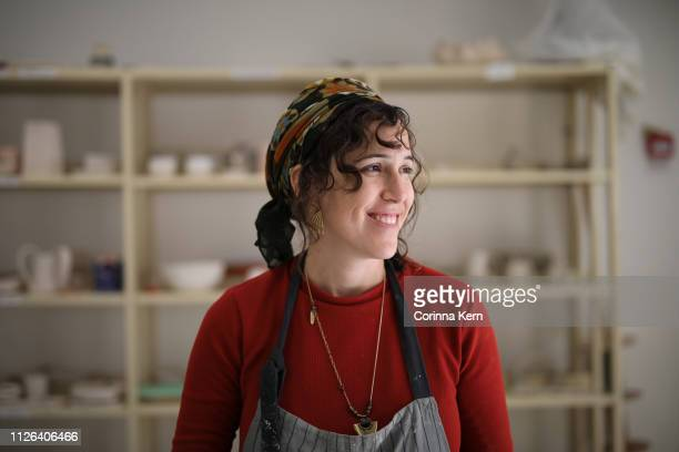 portrait of woman pottery artist in studio - israeli woman stock pictures, royalty-free photos & images
