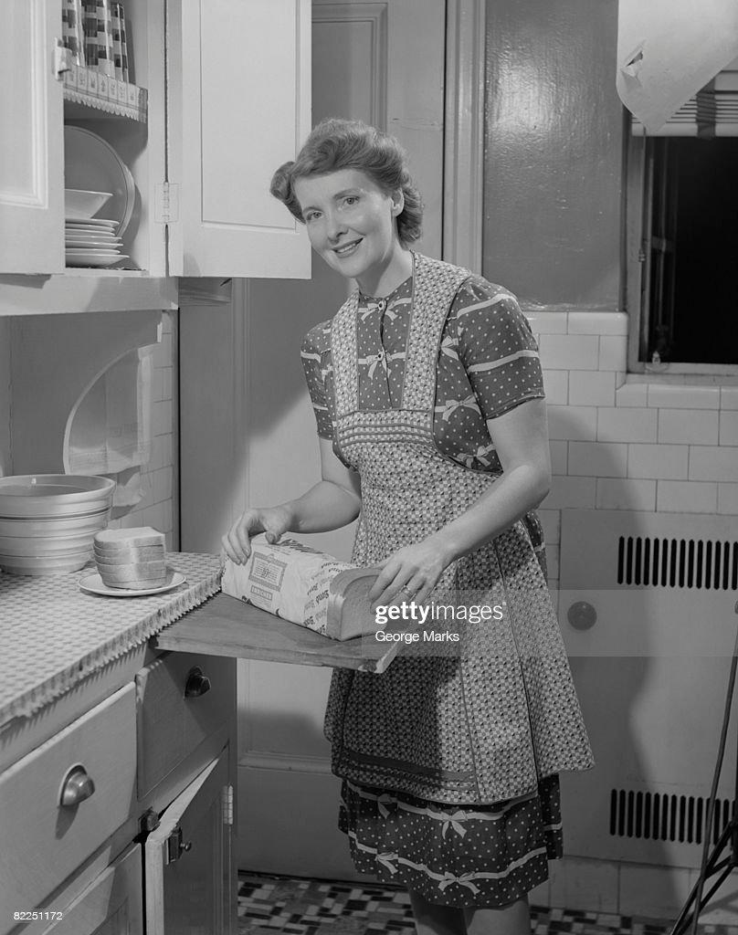 Portrait of woman preparing breakfast in kitchen : Stock Photo