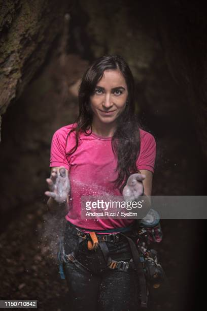 portrait of woman preparing for rock climbing - andrea rizzi stock pictures, royalty-free photos & images
