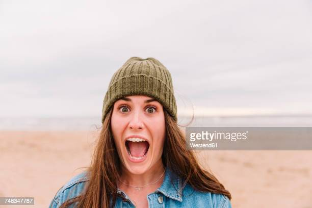 Portrait of woman pulling funny face on the beach