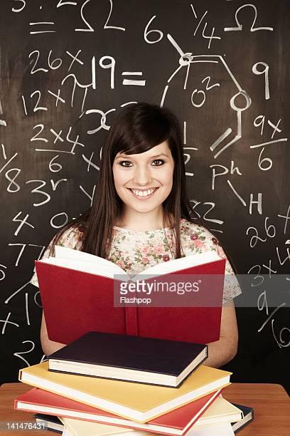 Portrait of  woman reading in school class