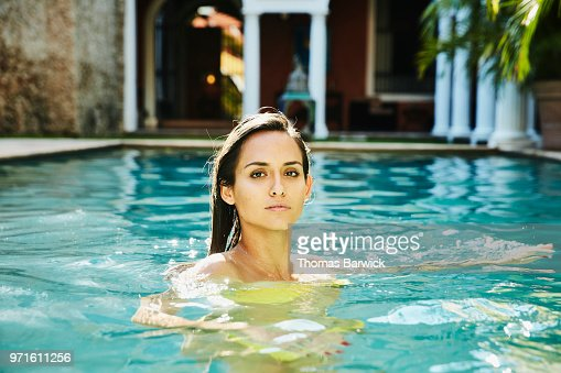 Portrait of woman relaxing in pool at outdoor spa