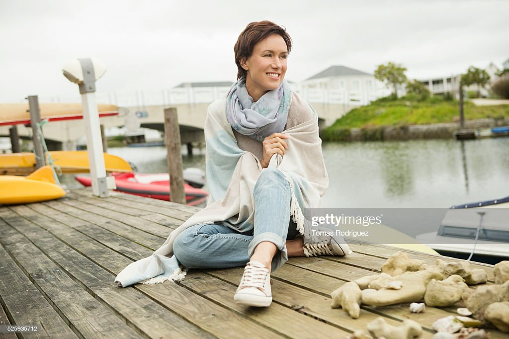 Portrait of woman relaxing on deck : Stock Photo