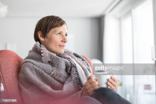 Portrait of woman relaxing with cup of coffee at home