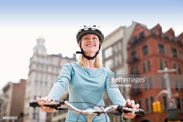 Portrait of woman riding bicycle in city