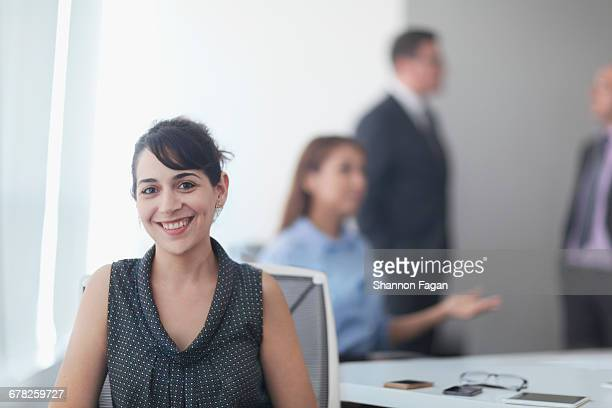 Portrait of woman sitting in business office