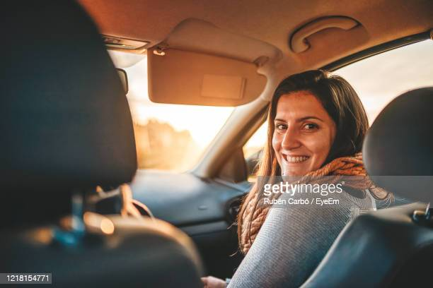 portrait of woman sitting in car - ecstatic stock pictures, royalty-free photos & images