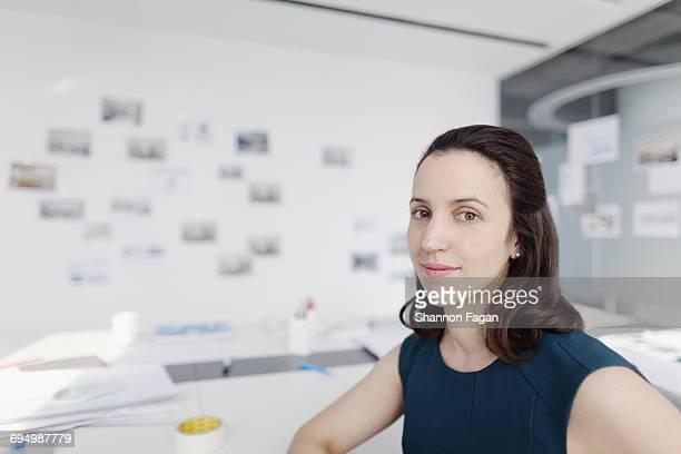 Portrait of woman sitting in design office