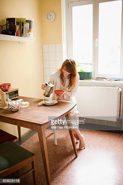 Portrait of woman sitting in kitchen