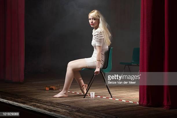 portrait of woman sitting on stage. - acteur photos et images de collection
