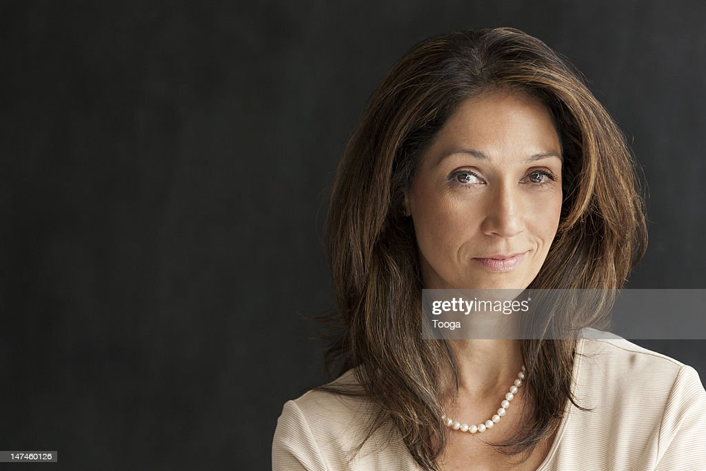 Portrait of woman sly grin : Stock Photo