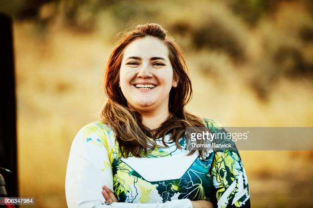 Portrait of woman smiling after riding dirt bikes in desert