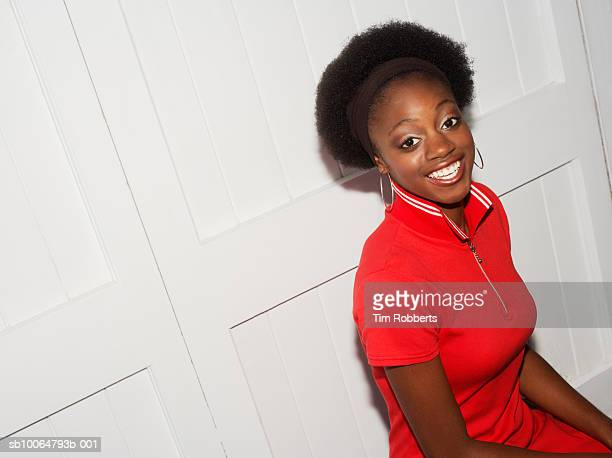 portrait of woman smiling against doors, elevated view - one young woman only stock pictures, royalty-free photos & images