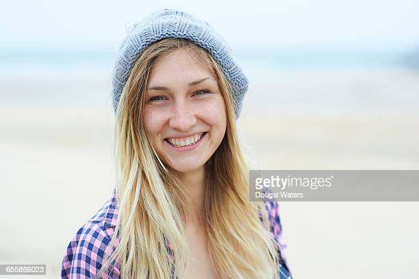 Portrait of woman smiling at beach.