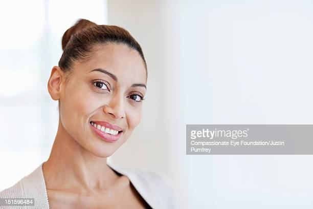 Portrait of woman smiling, close up