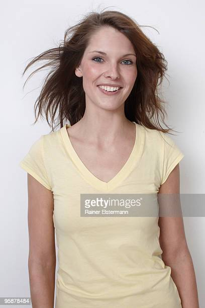 Portrait of woman smiling, hair blowing