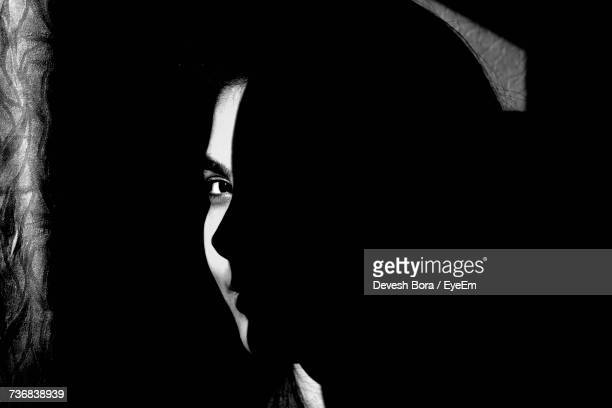Portrait Of Woman Smiling In Darkroom