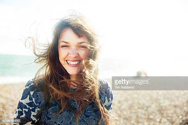 Portrait of woman smiling on beach