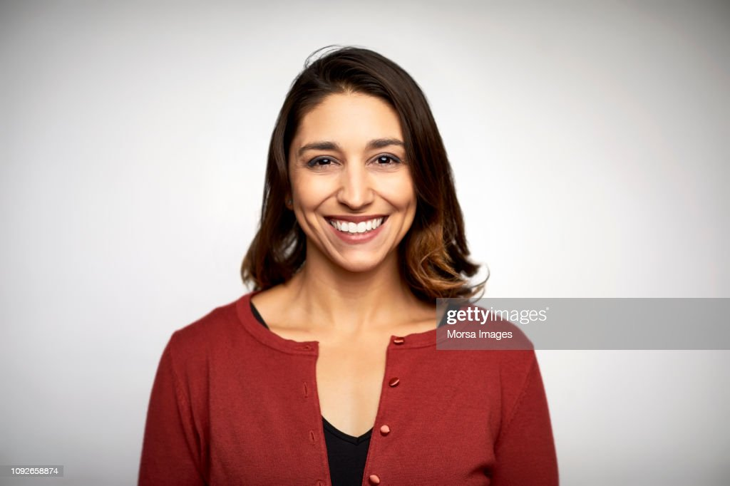 Portrait of woman smiling on white background : Foto stock