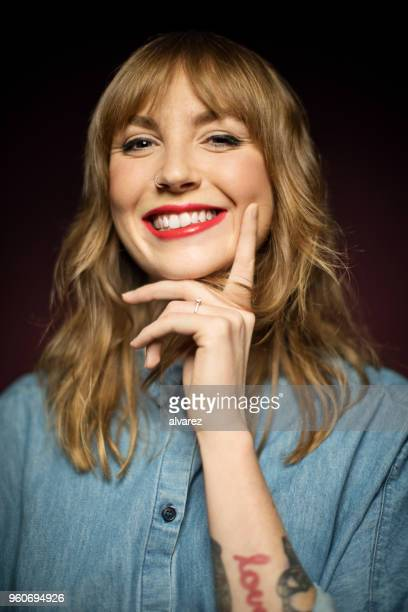 portrait of woman smiling over colored background - bangs hair stock pictures, royalty-free photos & images