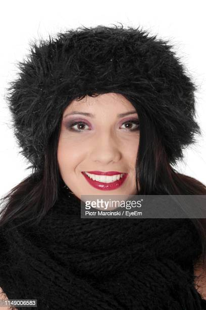 portrait of woman smiling - fur hat stock pictures, royalty-free photos & images