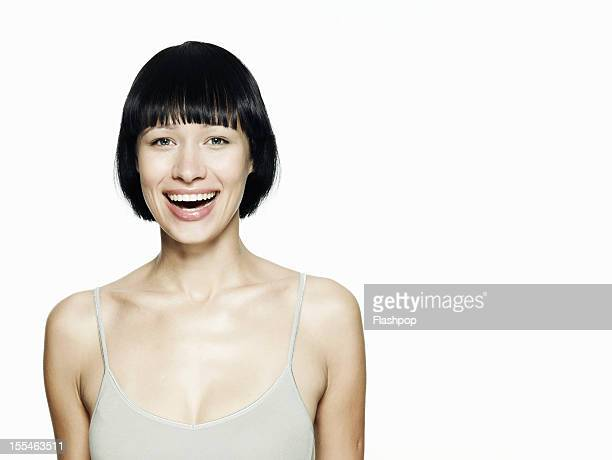 portrait of woman smiling - schwarzes haar stock-fotos und bilder