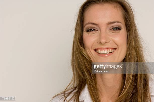 portrait of woman smiling - open blouse stock photos and pictures
