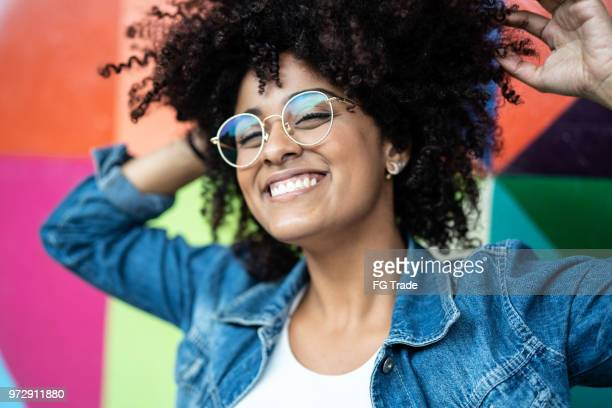 portrait of woman smiling with colorful background - fashionable stock pictures, royalty-free photos & images
