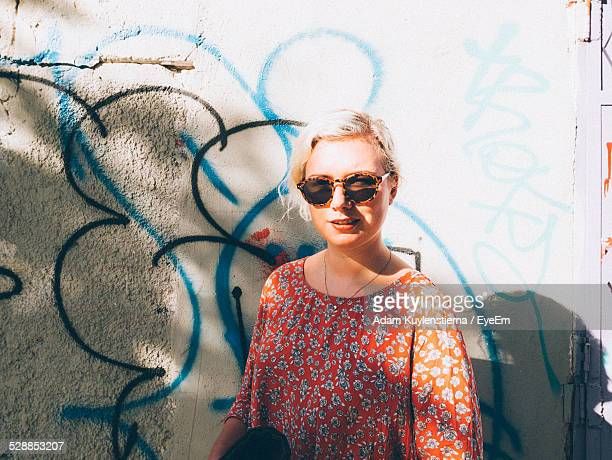 portrait of woman standing against graffiti - israeli woman stock pictures, royalty-free photos & images