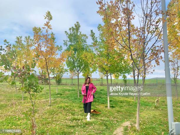 portrait of woman standing amidst trees - jessa stock pictures, royalty-free photos & images