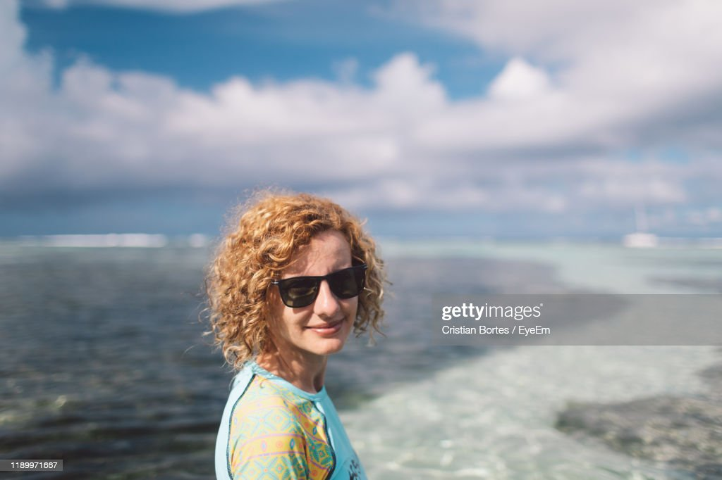 Portrait Of Woman Standing At Beach : Stock Photo