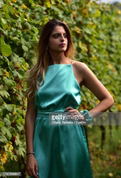 portrait of woman standing by vineyard - evening gown stock pictures, royalty-free photos & images