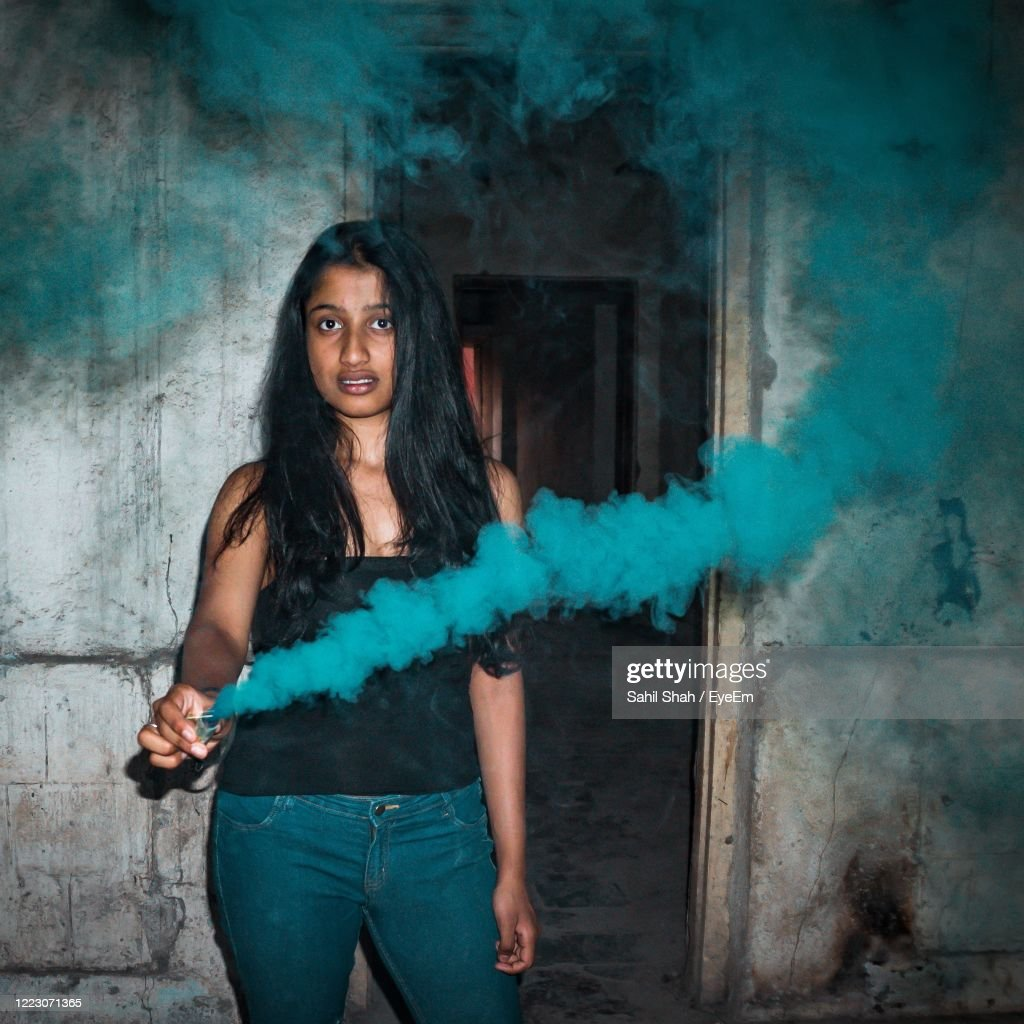 Portrait Of Woman Standing In Abandoned Building With A Smoke Bomb High Res Stock Photo Getty Images