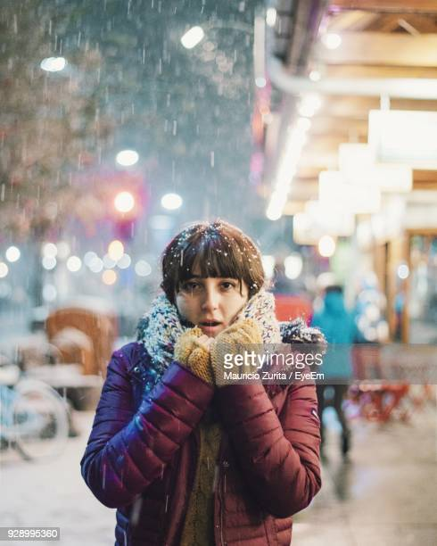 Portrait Of Woman Standing In City During Snowfall