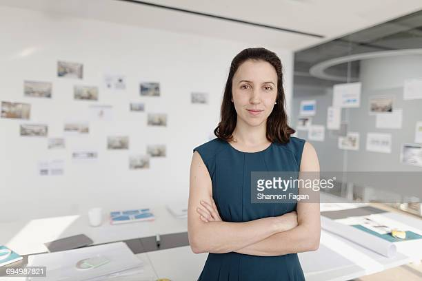 portrait of woman standing in design office - sleeveless stock pictures, royalty-free photos & images