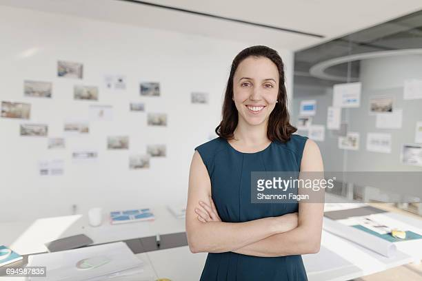 portrait of woman standing in design office - one mid adult woman only stock pictures, royalty-free photos & images