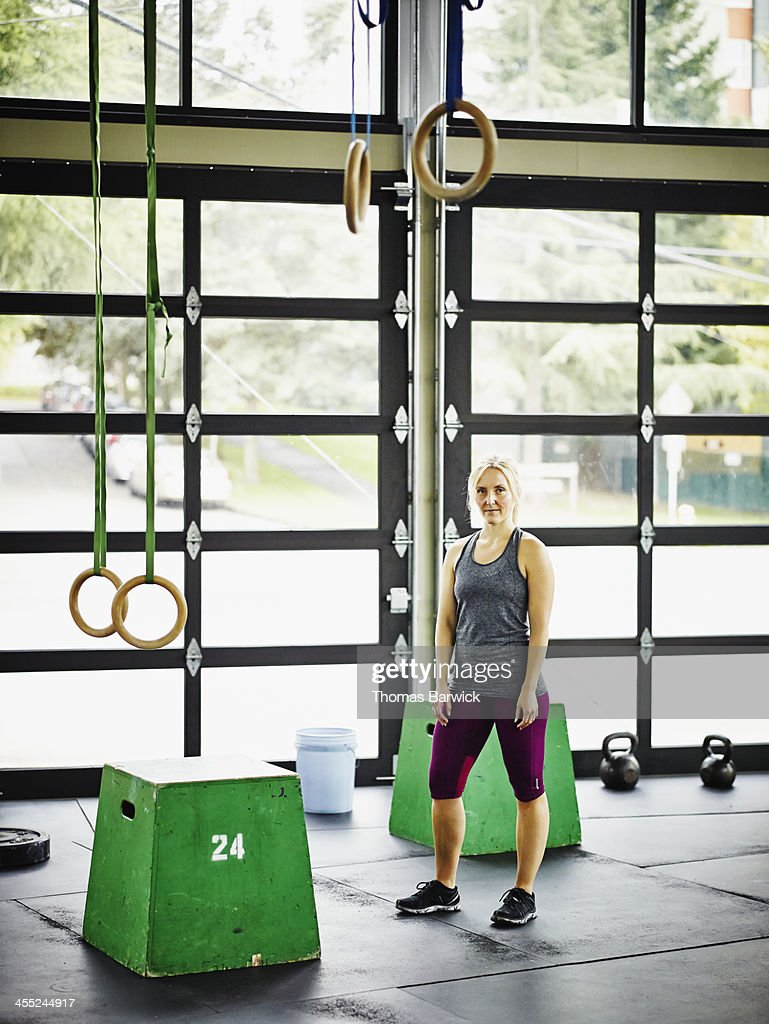 Portrait of woman standing in gym during workout : Stock Photo