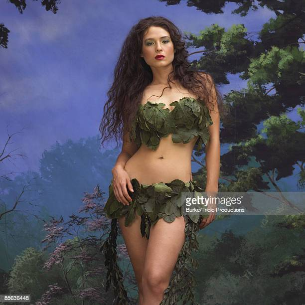 Portrait of woman standing in leaves