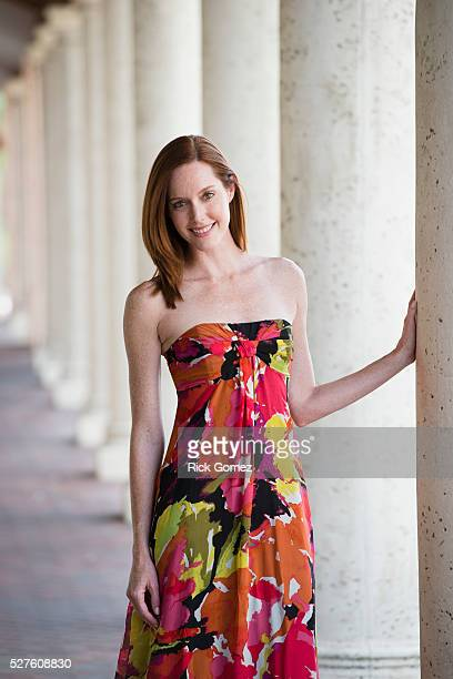 Portrait of woman standing next to column, Florida, USA