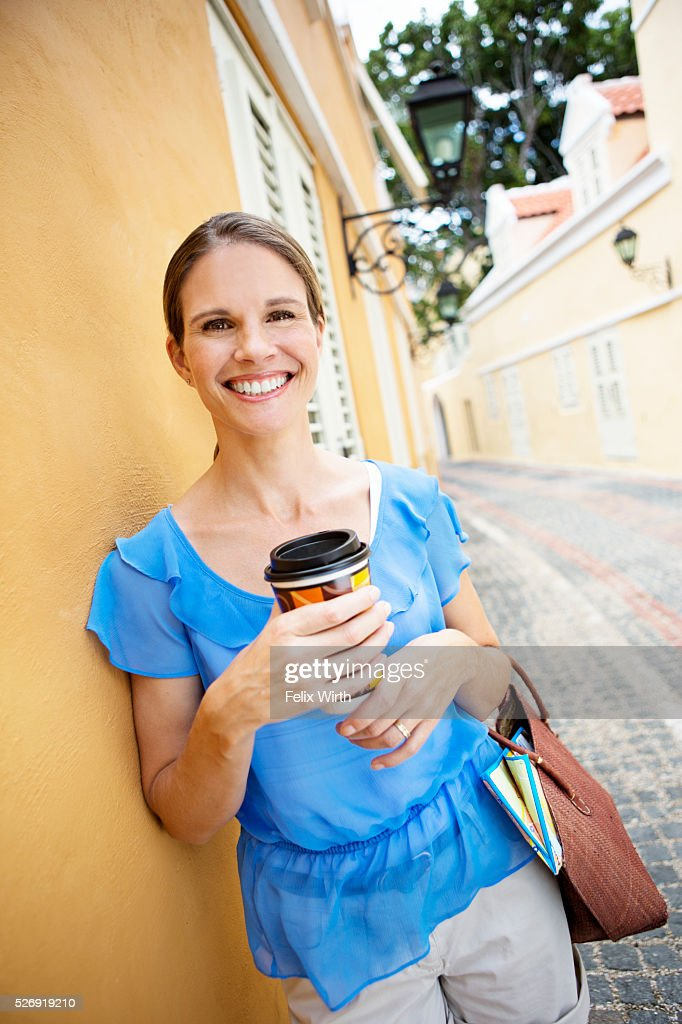 Portrait of woman standing on narrow street : Photo